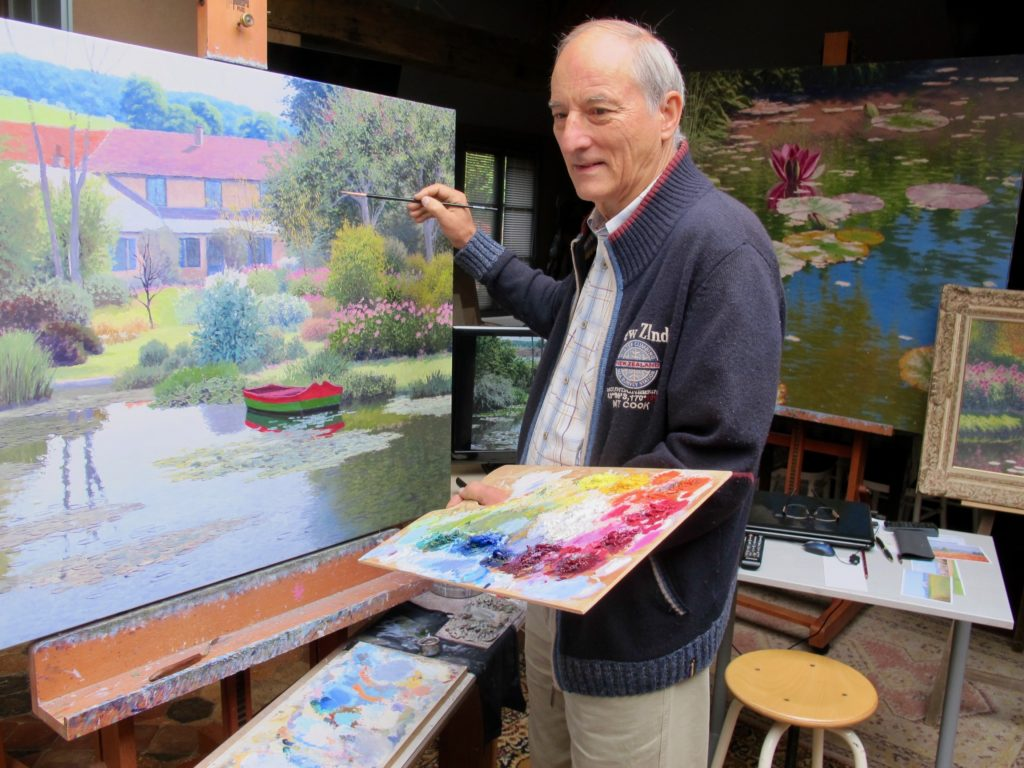 André van Beek entrain de peindre